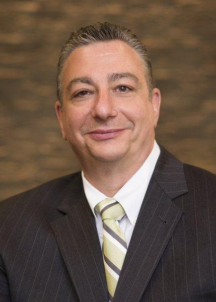 Mark A. Tronconi, CPA, MBA