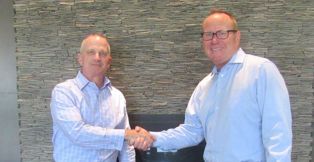 Jim Segarra (left) welcomes Scott Cain to Tronconi Segarra and Associates